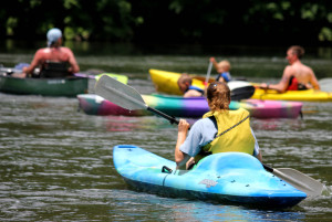 Kayaking is a popular activity at the park on a warm day.