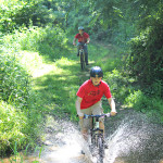 Bicyclists riding along one of the many picturesque trails located at Sky Meadows 2