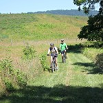 Bicyclists riding along one of the many picturesque trails located at Sky Meadows 1